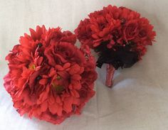 Red gerbera, red roses with black beading and black netting finish by Cathey's flowers