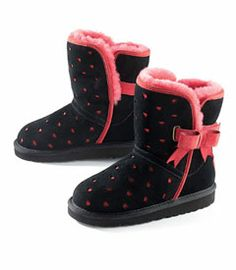 heart & bow ugg® boots - Pretty red hearts and decorative bows dress up her favorite boots. Snuggly and warm, this super-cute style is crafted with rich sheepskin uppers, shearling linings and rugged EVA soles.