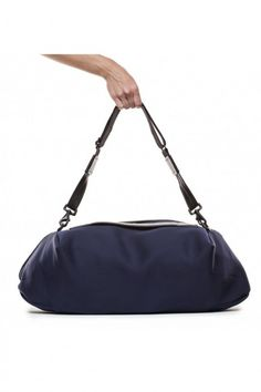 7ef8378941 This expandable gym bag from The Transience is made with neoprene spacer  mesh fabric and features