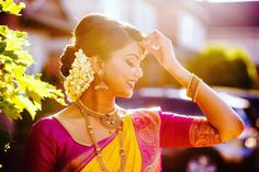 South Indian bride. Gold Indian bridal jewelry.Temple jewelry. Jhumkis. Yellow silk kanchipuram sari with contrast pink blouse.braid with fresh jasmine flowers. Tamil bride. Telugu bride. Kannada bride. Hindu bride. Malayalee bride.Kerala bride.South Indian wedding.