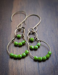 Cute earrings that could be made with some needle nose pliers, clippers and the wire and beads of your choosing.