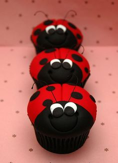 Ladybug/ladybird cupcakes ... chocolate mud cupcakes iced with red and black fondant in an attempt to look like a ladybird/lady bug.