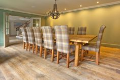 Winchester Antique engineered oak wood flooring with an aged and distressed surface to replicate a reclaimed oak board. Fitted throughout ground floor of large new home in Sunningdale Berkshire. Shown here in Dining Room.