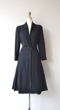 Vintage 1950s black mid-weight wool fit & flare coat with turn down collar, one button large frog closure at the waist, fantastic draped back with tie closure and great sweep. Black silk lining. --- M E A S U R E M E N T S --- fits like: medium shoulder: 15 waist: up to 31 hip: free sleeve: 23 length: 46 brand/maker: Roberts | Gay & High condition: excellent ★ layaway is available for this item ➸ More vintage coats http://www.etsy.com/shop/DearGolden?secti...