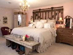 Rustic bedroom with old barn door for headboard.