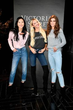 Liu Wen Candice Swanpoel and Taylor Hill pose at the Victoria's Secret Store At Lippo Plaza Appearance at Victoria's Secret on November 18 2017 in...