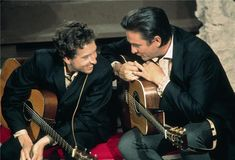 Bob Dylan and Johnny Cash. Los Angeles, 1969. I don't think I've ever seen a smile that big on Dylan's face.  Because Cash sucker punched it off him!  Well, if you're traveling the north country fa...