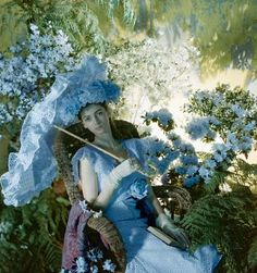 Cecil Beaton for Vogue, 1946  Model seated in garden holding parasol to match her eyelet dress by Sophie of Saks Fifth Avenue, and wearing a ruffled straw hat by Tatiana du Plessix.