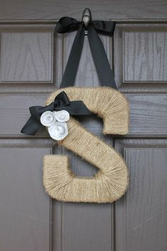 Letter on door - cute. Wooden letter wrapped in twine with ribbon glued on back.