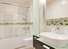 """Tiled border around circumference of entire bathroom rejected.  This tile is both hideous and too """"tall,"""" but even if it weren't, the look seems awkward and dorky to me.  BUT am I creating the same problem with a chair rail?  How to coordinate the shower border with the chair rail?"""