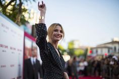 """Cast member Cameron Diaz waves at the premiere of """"Sex Tape"""" in Los Angeles, California July 10, 2014. REUTERS/Mario Anzuoni"""