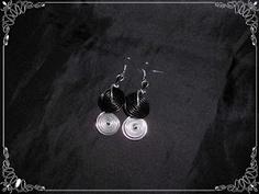 Pendientes espiral en negro y plata...