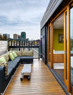 Great idea for a condo balcony: sliding glass doors and a modular sofa and coffee table. (Special order a similar sofa at Rich's.)