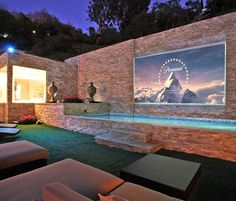 Check out this outdoor theater! You could fit the whole neighborhood in your backyard! Amazing that you can have the neighborhood over to watch movies in the yard! You can even swim in the gorgeous pool beneath the screen while More