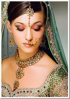 indian bridal wear. the makeup is spectacular too.