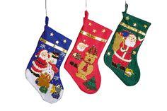 Drei textile Nikolausstiefel mit weihnachtlichen Stickereien bieten Platz für Lebkuchen, Nüsse und andere Leckereien. Die verschiedenen Ausführungen in blau, rot und grün mit jeweils unterschiedlichen Motiven lassen Kinderaugen leuchten. ca. 30 x 44 cm
