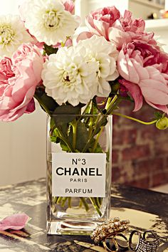 A snoozy vase gets an elegant makeover when you print out a sticker that makes it look like a perfume bottle. Can't make stickers in your printer? Draw a label on a piece of heavy paper and use glass glue.