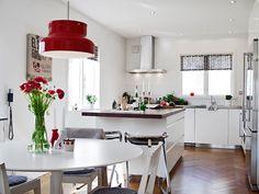 cherry red pendant, wood herringbone floor, white kitchen