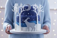 Wintery cakes, beautiful winter night cake with trees and deer. Christmas.