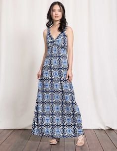 Embrace sunny weather with this sophisticated maxi dress. The V-shaped  neckline and twisted 7db4abfe1