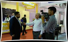 A visitor interacting with Mr. Ranojit Chatterjee, Charge d'affaires, Embassy of India in Amman, Jordan at EEPC India booth.