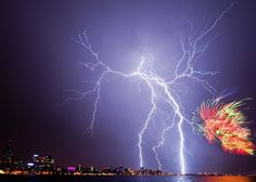 """Man vs Nature: Outdoor Scenes. """"A balmy 41 degree day and ominous storm clouds promised a little more excitement than normal at Perth's Australia Day celebrations. The crowd was more impressed with the lightning than the million dollar fireworks and this photo shows why."""" Location: Perth, Western Australia, Australia. Photo #48 and """"quoted"""" caption by © Matthew Titmanis/National Geographic Traveler Photo Contest  A snapshot from mountaineer's life Sense of Place"""