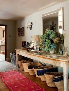 Rustic Foyer with the focus on the floor. The brick floor is lined with an assortment of market baskets.
