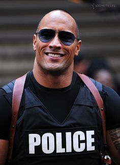 dwayne johnson..... he can search, cuff and arrest me ANYTIME!!!!!!!!!!!!!! I would prposely commit a crime to be arressted y him