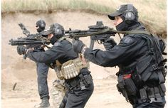 Members of the RCMP Emergency Response Team (ERT) shoot with MP5 firearms while doing their regular monthly training