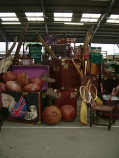warehouse- an assortment of vintage luggage and sports equipment -The Arts & Crafts Home