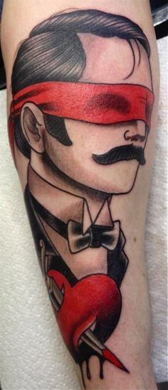 By Ben Stone from Lifetime Tattoo.  Love black and red.