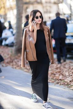 Miroslava Duma wears a black maxi dress, brown leather motorcycle jacket, round sunglasses, and black Converse sneakers / fashion / street style / outfit inspiration Jeans Y Converse, Dress With Converse, Converse Sneakers, Black Converse, Green Sneakers, Fall Maternity Outfits, Maternity Fashion, Pregnancy Fashion, Pregnancy Outfits