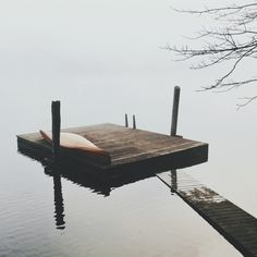 as the dock becomes apart of the water that shares the picture of the rising grey sky,  as if the misty waters are trying to share the secret of its very existence, you shed a tear of joy yet filled with a drop of remorse it is changing and always filled with adventure.