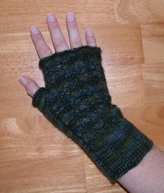 Cabled Fingerless Mitts by Knitamazoo | Knitting Pattern - Looking for your next project? You're going to love Cabled Fingerless Mitts by designer Knitamazoo. - via @Craftsy