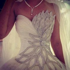 dress wedding dress clothes: wedding wedding weddingdress bling glitz blingdress glitzdress blingweddingdress glitzweddingdress white dress prom dress silver beautiful white elegant bag ball gown wedding gown bling-bling white, wedding dress, flowers, flower petals, pearls, fitted, ballgown