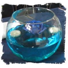 DIY could be cute with just white candles! Just add blue food coloring...awesome!
