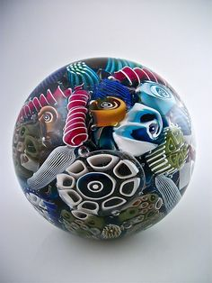 "Art-glass paperweight entitled ""Ocean Reef Paperweight Sphere,"" created by Michael Egan"