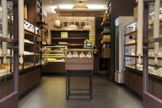 "With the increase in growth of baked products and bread in China, Andersen's bakery wanted to develop smaller ""neighborhood"" style bakeries with the hope of encouraging the european style of daily shopping of specialist foods. It was important to invoke the feeling of classic european patisseries through the selection of materials and finishes. The reference to New Zealand in the design refers to the sourcing of ingredients."
