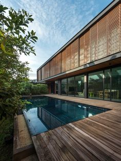 Image 8 of 42 from gallery of House / OfficeAT. Photograph by Rungkit Charoenwat Residential Architecture, Contemporary Architecture, Amazing Architecture, Sketch Architecture, Modern Tropical House, Tropical Houses, Modern Villa Design, Suburban House, Modern Architects