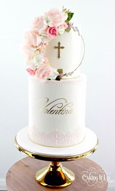 Two tier christening cake with double barrel tier featuring a handmade floral wreath and delicate hand painted name in gold. Edible lace and hand pipe. Christening Cake Girls, Baby Girl Baptism, Baptism Cakes, Baptism Party, Baptism Ideas, Baptism Themes, First Communion Cakes, First Holy Communion, Comunion Cakes