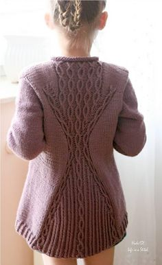 """""""Cabletta Junior"""" is a beautiful garment with an interesting hourglass shape on the back inspired by a store bought sweater.This cardigan is knit top down, completely seamlessly with set in sleeves worked using short rows. First, you knit the back and then both fronts. When you reach the underarms, join all pieces to work them together. Once you complete the body, pick up the stitches around the armholes to work the sleeves from the top down…"""