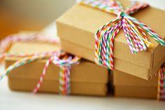 How sweet! Simple box with multi-colored baker's twine  Get supplies at Flower Factory www.flowerfactory.com