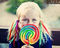 Lollipop makes her happy!