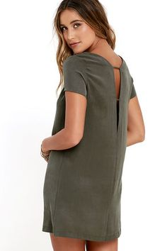 Take a mini vacation every time you slip on the Mumbai the Way Washed Olive Green Shift Dress! Soft and sleek woven fabric shapes short sleeves, rounded neckline, and straight-cut bodice with darting. The effortlessly cool silhouette gets a sultry peek of skin at back, thanks to a strappy V cutout.