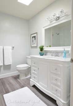 Beautiful Bathroom Remodel - walls Glidden Chelsea Fog, vanity from Wayfair - KBC Datherine 48 Vanity with carrara marble top and chrome faucets, Grey maple Trafficmaser Allure vinyl plank flooring, tub converted into walk in shower, Allen Roth mirror fr Diy Bathroom Remodel, Basement Bathroom, Bathroom Flooring, Bathroom Renovations, Home Renovation, Home Remodeling, Wood Flooring, Bathroom Vinyl, Bathroom Makeovers