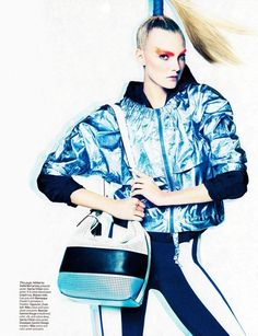 Top model Caroline Trentini goes active in Tom Munro's photoshoot for the February issue of W Magazine. Styled by Giovanna Battaglia, Caroline wears designs from Adidas, Lacoste, Stella McCartney, Giuseppe Zanotti, Nike and others. Dancers are Brahim Zaibat and Loic Mabanza.