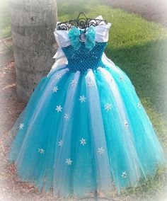 Frozen inspired Elsa dress w/ personally hand crafted snow flake/rhinestone. Let your Princess be the Snow Queen she wants to be.