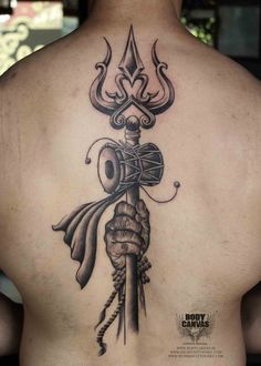 om-in-sun-tattoo-on-man-back-shoulder-small-spiritual-concept-lord-ganesha-small-Om-With-Trishul-Tattoo-Designs-spiritual.