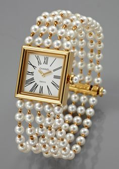 Beautiful Chanel five strand pearl & gold bracelet watch! Chanel Jewelry, Pearl Jewelry, Pearl Rings, Pearl Bracelets, Pearl Necklaces, Jewelry Bracelets, Bling Jewelry, Beaded Watches, Jewelry Watches