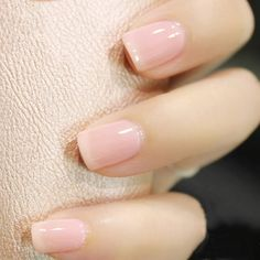 """I always end up doing """"natural"""" nails at work, and I tend to favour transparent neutral pinks and corals, that  allow me to strengthen opacity with multiple applications."""